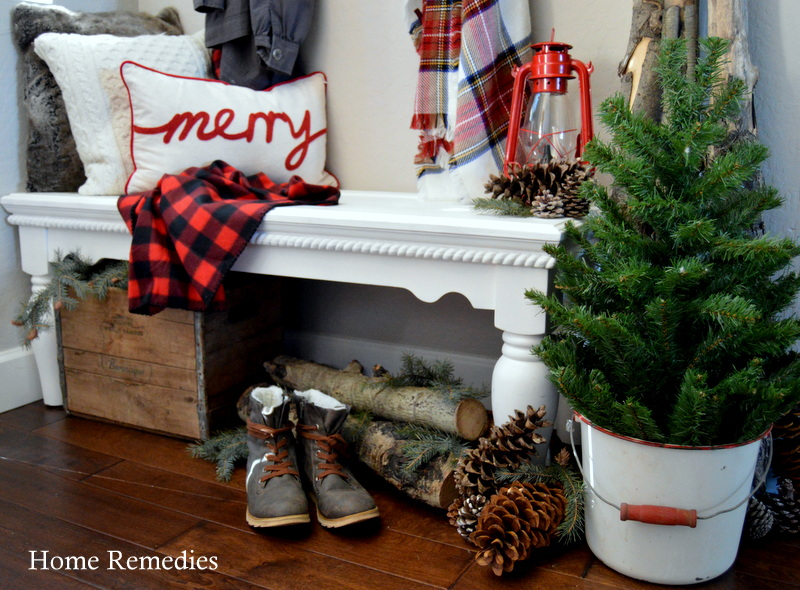 A Cozy Farmhouse Christmas Entryway with plaids and patterns for a warm, rustic feel! From HomeRemediesRx.com